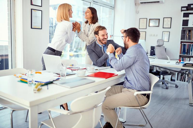 Business coworkers successfully completed business meeting. Happy business coworkers successfully completed business meeting royalty free stock images