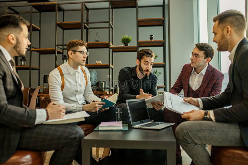 Business coworking of young men in office royalty free stock photography