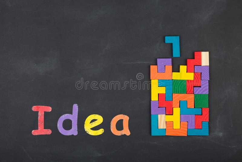 Business creative idea concept inscription and jigsaw blocks on the blackboard. Business creative idea concept - inscription and jigsaw blocks on the blackboard stock images