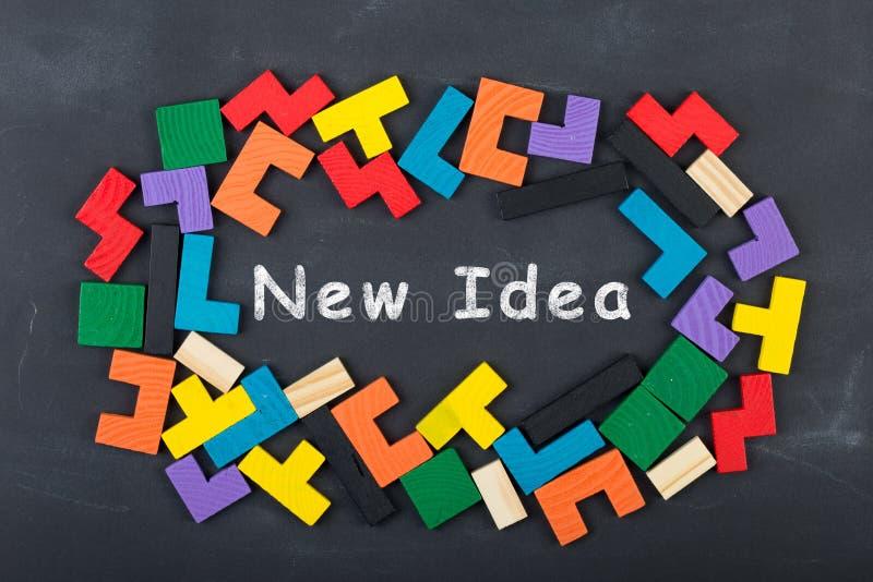 Business creative idea concept - inscription and jigsaw blocks on the blackboard. Bulb strategy market education chalkboard background theory solution knowledge stock photos