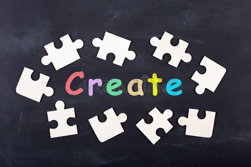 Business creative idea concept - inscription and jigsaw blocks on the blackboard. Bulb, strategy, market, education, chalkboard, background, theory, solution stock photo