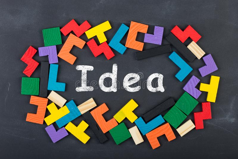 Business creative idea concept - inscription and jigsaw blocks on the blackboard. Bulb, strategy, market, education, chalkboard, background, theory, solution royalty free stock photos