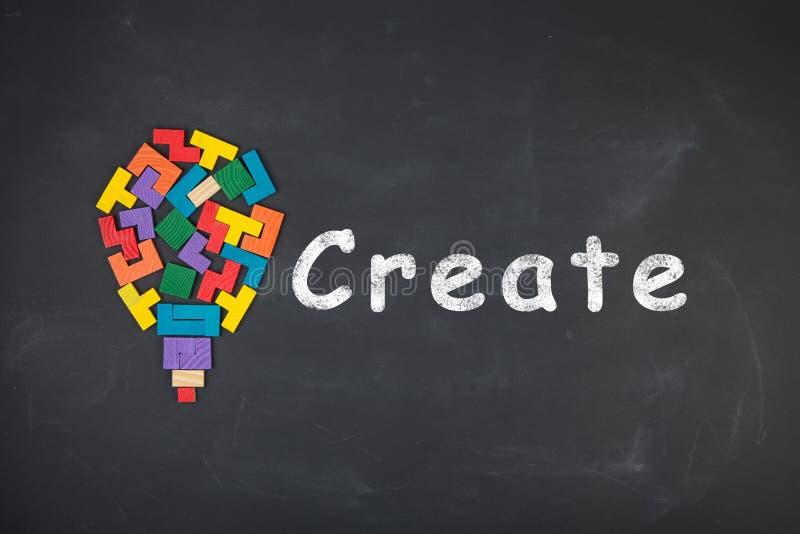 Business creative idea concept - inscription and jigsaw blocks on the blackboard. Business creative idea concept - inscription and bulb of jigsaw blocks on the stock photos
