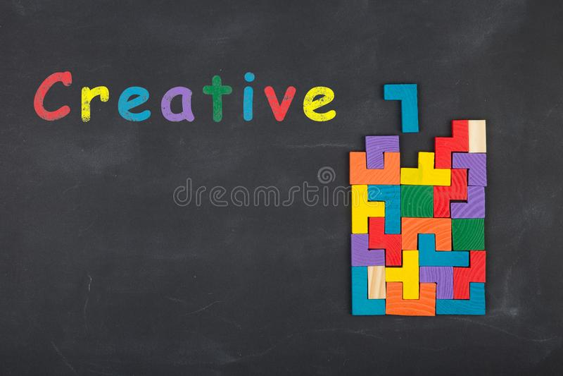 Business creative idea concept - inscription and jigsaw blocks on the blackboard. Business creative idea concept inscription and jigsaw blocks on the blackboard royalty free stock image