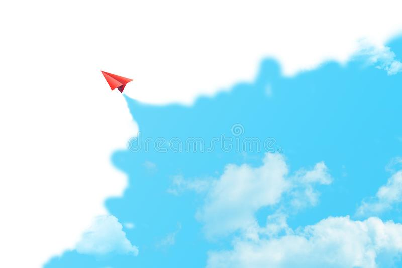 Red paper plane flying in blue sky surrounded with white clouds. royalty free stock photo