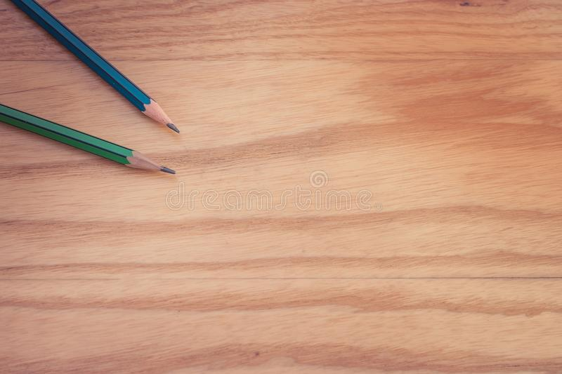 Business creative and idea concept top view of two pencil put on wooden floor. stock photo