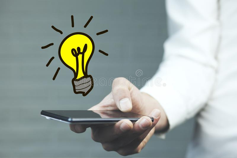 Business creativity idea light bulb concept on man hand stock images