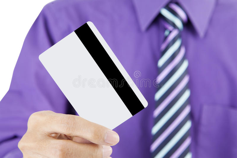 Business credit card. Close up of businessman holding a credit card royalty free stock images