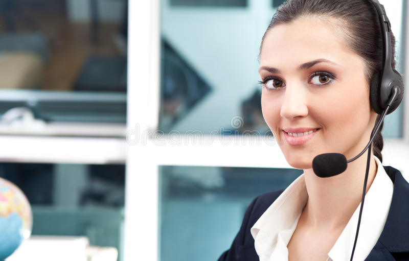 Business customer support operator. Woman smiling royalty free stock photo
