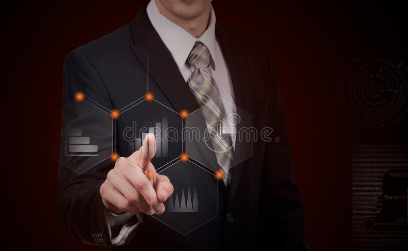 Business, cyberspace and future technology concept - close up of businessman in suit working with virtual charts over dark backg stock photo