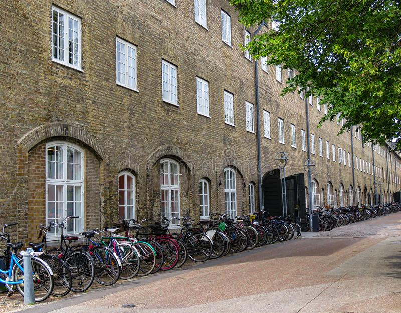 A business day in Copenhagen, Denmark. The morning rush hour is over and Copenhagen bicycles have settled into their daytime routine.  Set against the historic royalty free stock image