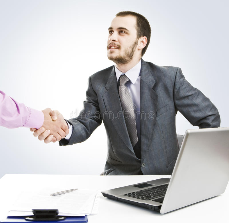 Business deal!. Deal! Young businessman makes a new contract royalty free stock photo