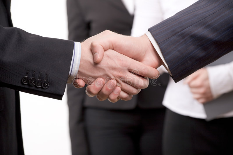 Business deal. Business people joining hands together for deal. Macro royalty free stock photo