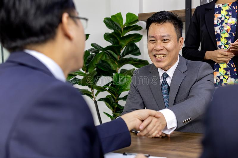 Business deal in a cafe stock photo