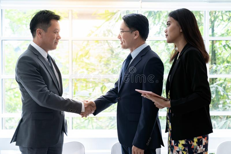 Business deal in a cafe. Handshake for Business deal Business Mergers and acquisitions royalty free stock image