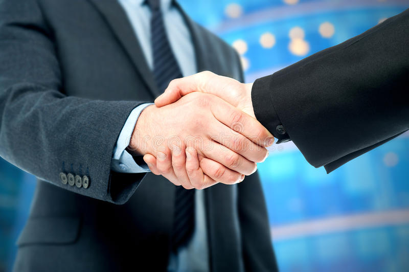Business deal finalized, congratulations!. Business handshake, the deal Is finalized royalty free stock photos
