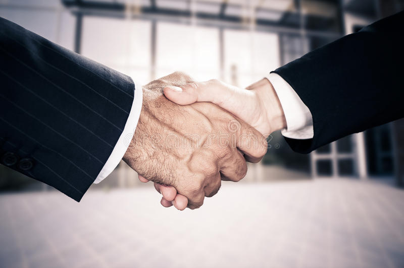 Business deal finalized. Business handshake, the deal Is finalized stock images