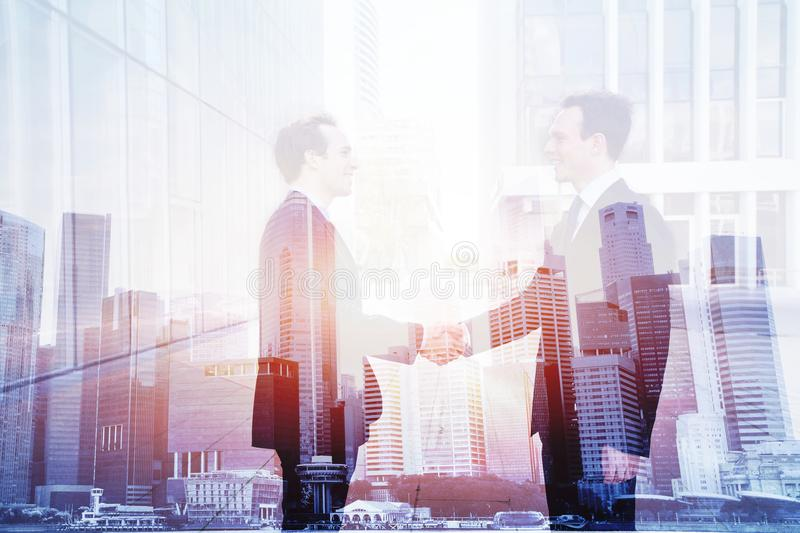 Business deal, handshake double exposure, cooperation concept stock photos
