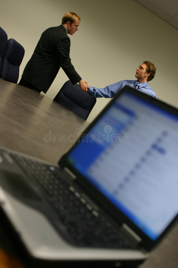 Business deal with laptop royalty free stock image
