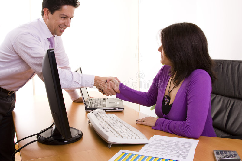 Business Deal At The Office Stock Photo
