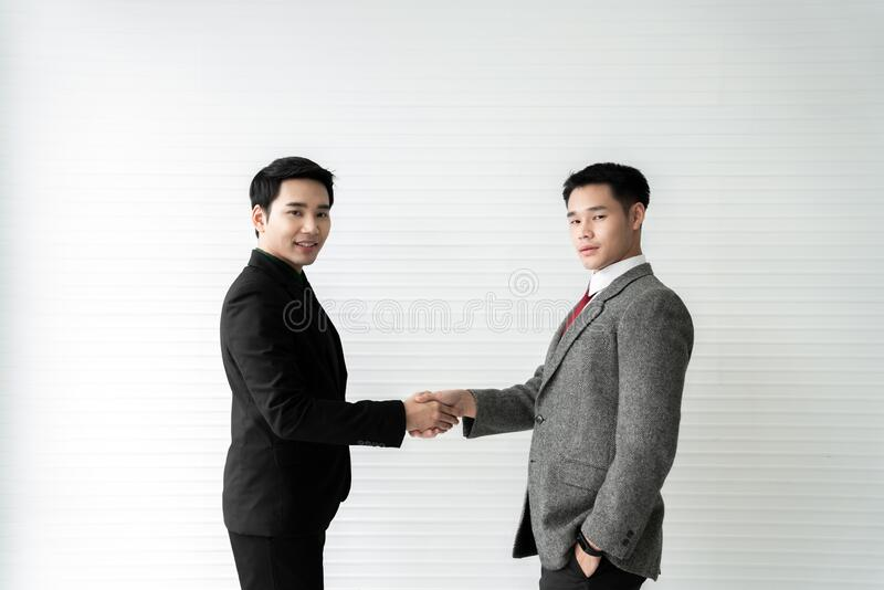 Business deal / two businessman handshake on white background / business concept /asian model.  stock photography
