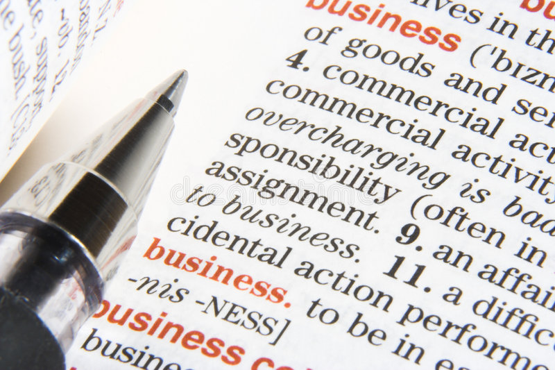 Business definition. A dictionary opened at a definition business, with a pen on it stock photos