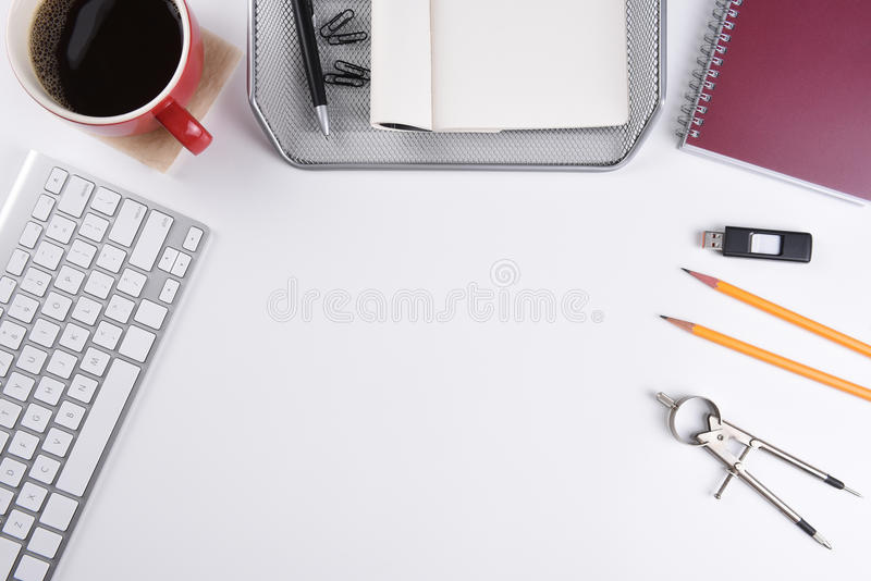 Business Desk. Overhead shot of a white business desk with copy space royalty free stock photography