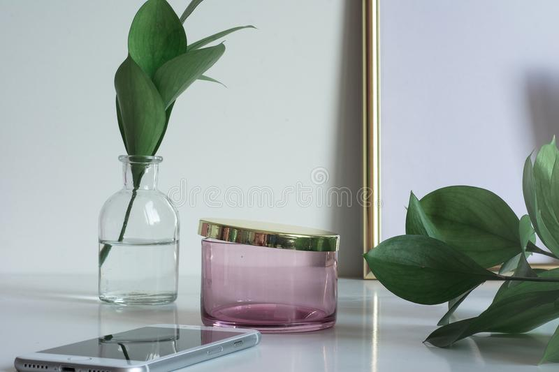 Business desktop with copy space glass vase leaves royalty free stock photo