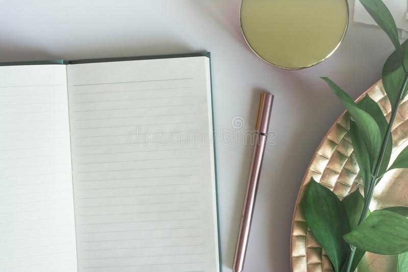 Top view desktop with notebook copy space leaves stock photos