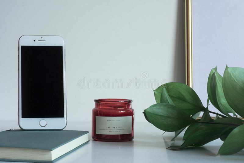 Business desktop with smartphone copy space candle royalty free stock photo