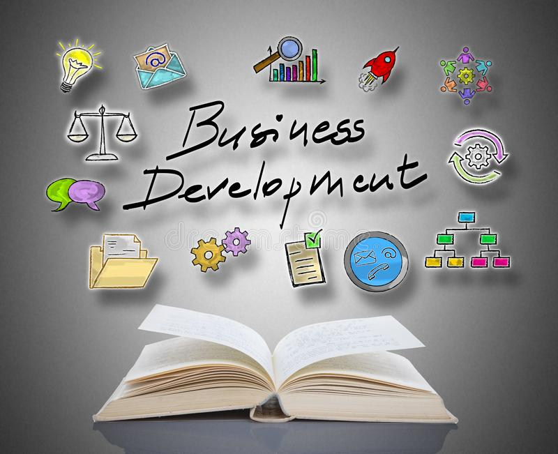Business development concept above a book. Business development concept above an open book royalty free stock image