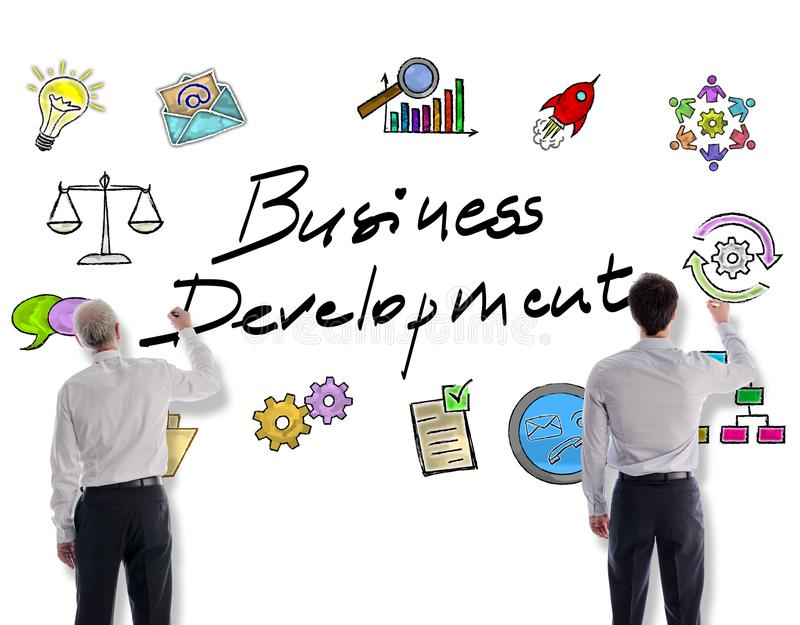 Business development concept drawn by businessmen. Business development concept drawn on a white wall by businessmen stock photography