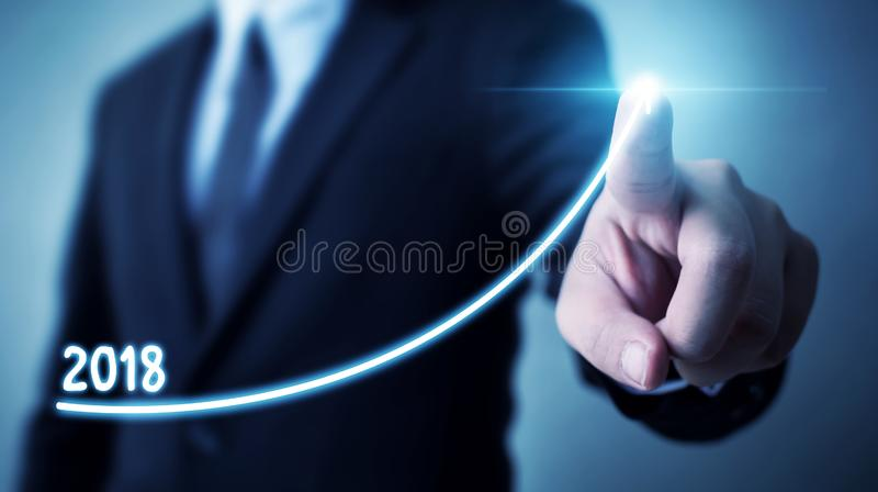Business development to success and growing annual revenue growth 2018 concept, Businessman pointing arrow graph. Corporate future growth plan royalty free stock images
