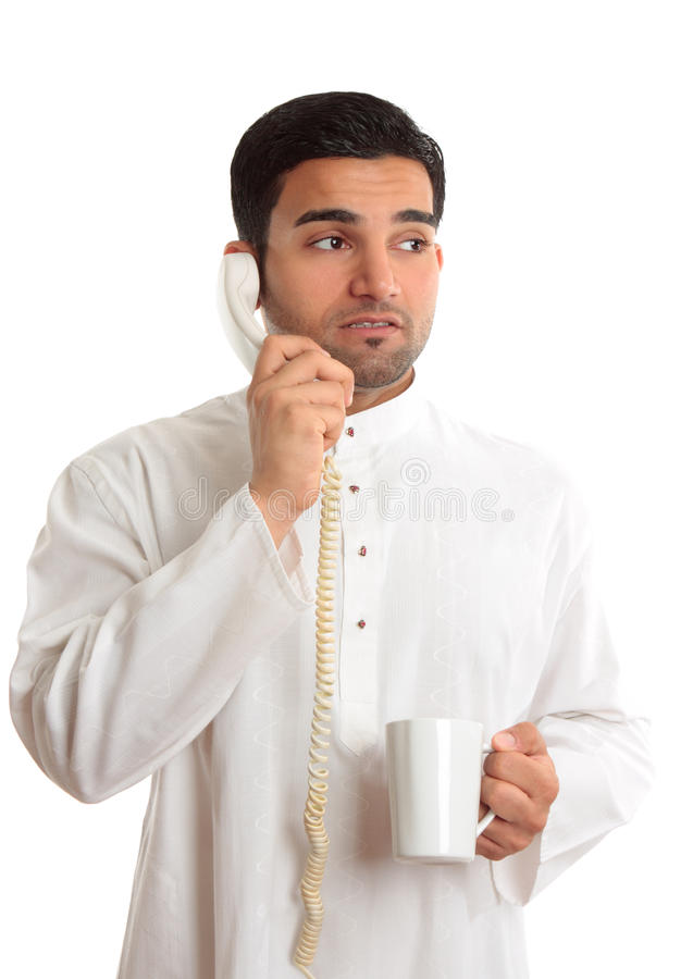 Business dilemma - worried man on phone stock image