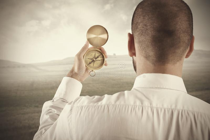 Business direction. Concept of business direction with businessman and compass royalty free stock image