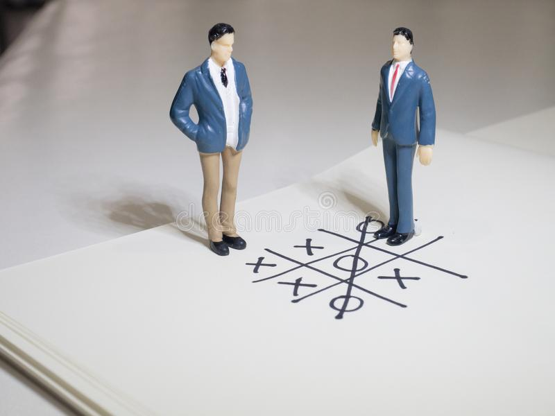 Business and direction concept. Businessman small figure standing on paper and center of circle with more arrows point to many di. Rection.Business concept idea royalty free stock images