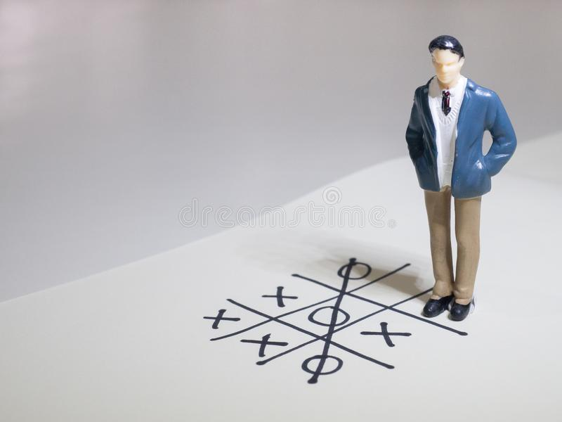 Business and direction concept. Businessman small figure standing on paper and center of circle with more arrows point to many di stock photo