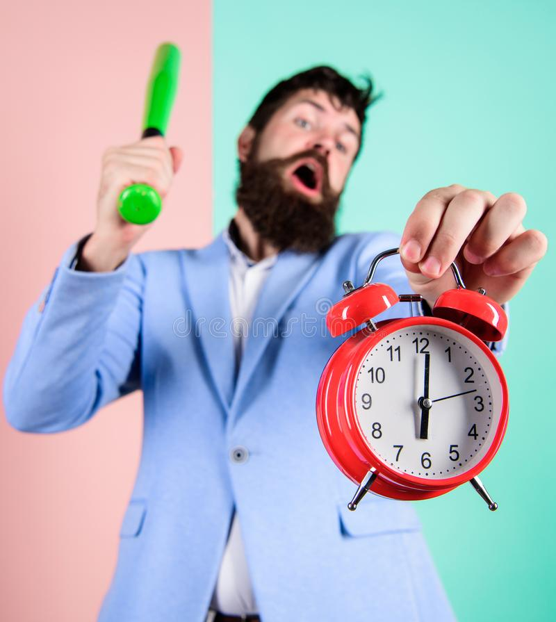 Business discipline concept. Time management and discipline. Discipline and sanctions. Boss aggressive face hold alarm. Clock. Destroy or turn off. Man suit royalty free stock photo