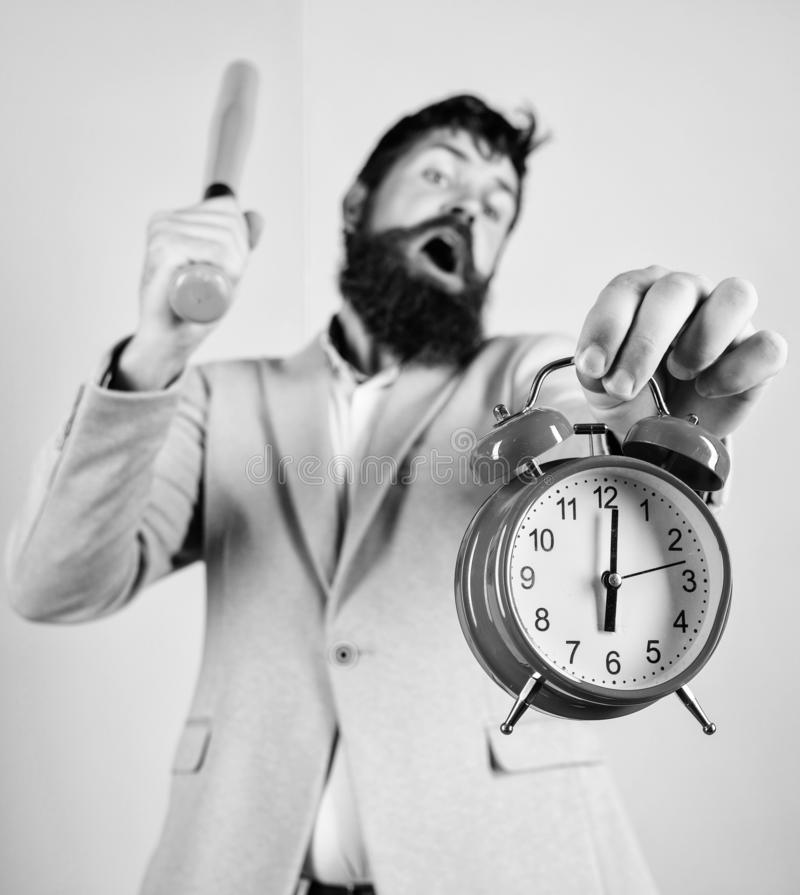 Business discipline concept. Time management and discipline. Discipline and sanctions. Boss aggressive face hold alarm stock photography