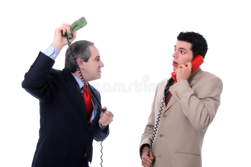 Phone call. Business men funny discussion over the phone over a white background royalty free stock image