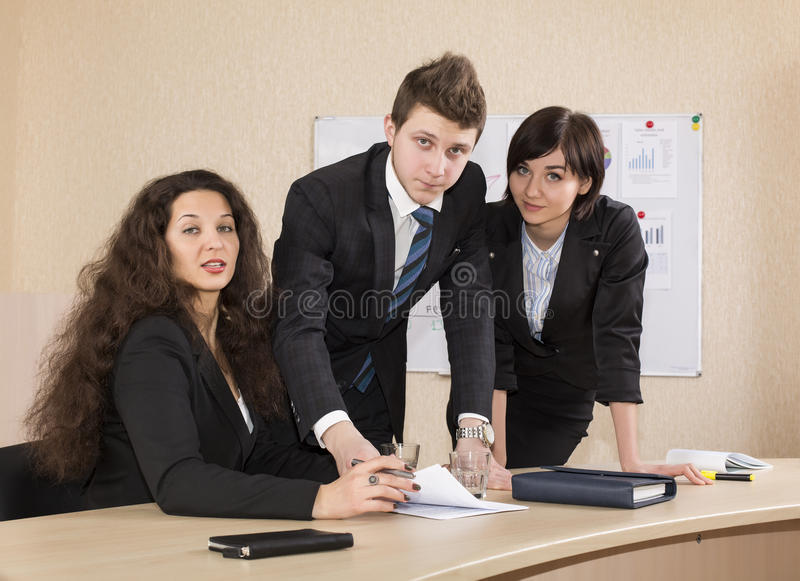 Business discussion. Group of young businesspeople discuss the idea with the charts and other paperwork on the table stock photos