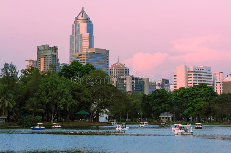 Business district cityscape from a Lumpini Park, Bangkok, Thailand at sunset time. stock photo