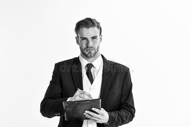 Business documents concept. Man with serious face writes on plan royalty free stock photography