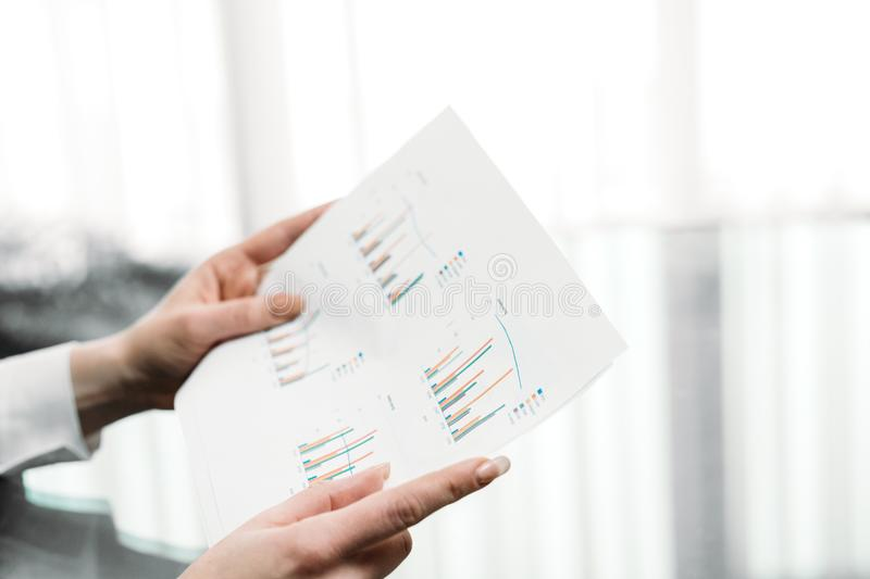 Business document graph data statistics report. Business documents graphs. hands holding papers. report statistics data analysis. office workplace royalty free stock images