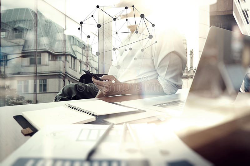 Business documents on office table with smart phone. And digital tablet and graph business with social network diagram and man working in the background royalty free stock photos