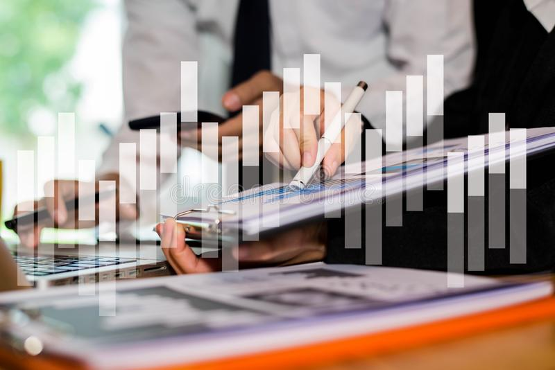 Business documents on office table and two colleagues discussing data in office. stock images