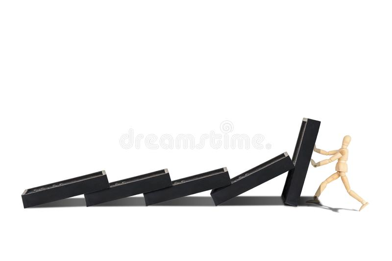 Wooden figure mannequin protect row of dominoes failing isolated on white background. royalty free stock photo