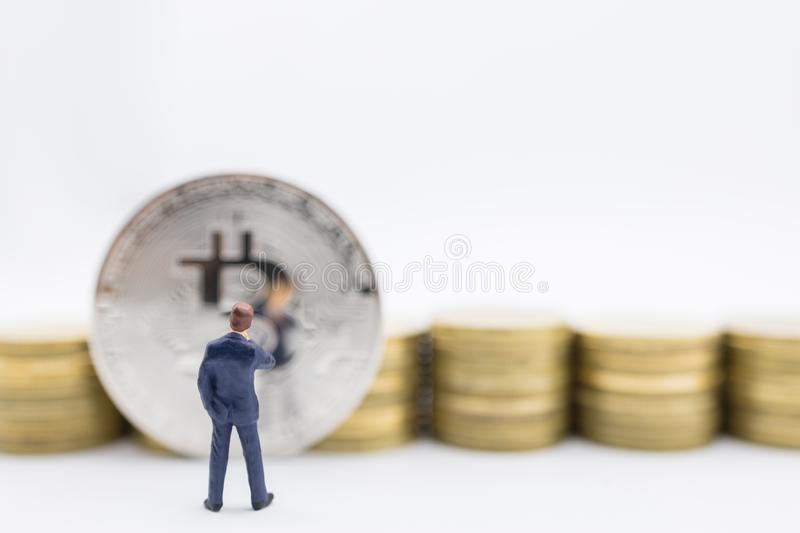 Business, e-commerce, crypto currency, finance and technology concept. Close up of businessman miniature figure standing and stock image