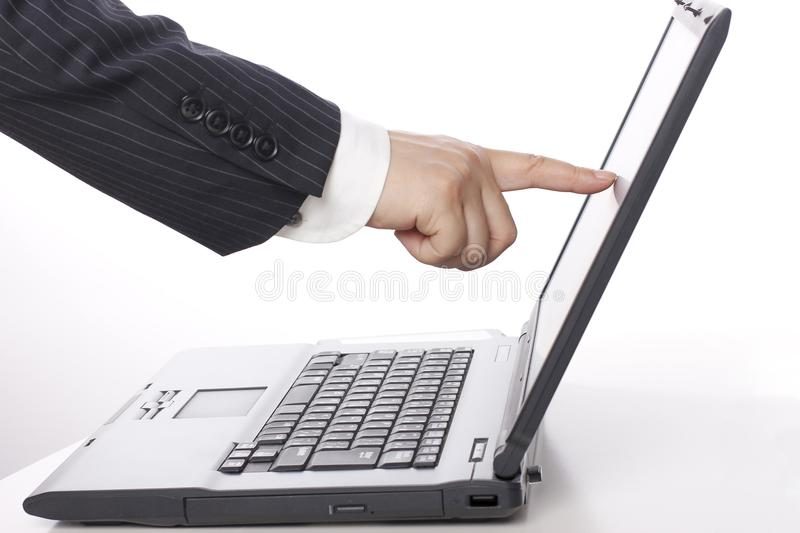 Business elite`s finger touch computer screen. He seems to be greeting the computer stock photo