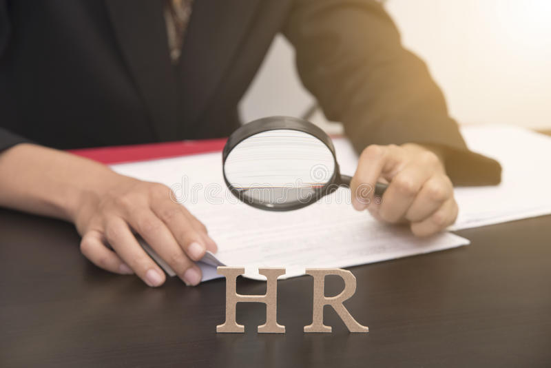 Business employer holding magnifying glass searching. concept HR royalty free stock images